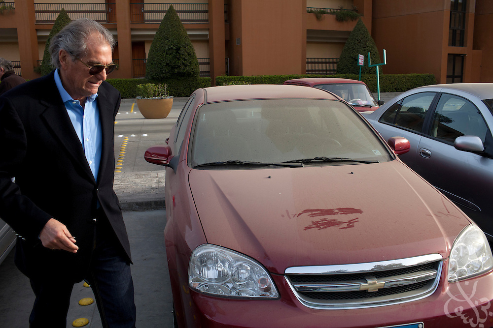 Manuel Jose, the Portuguese Coach of the Egyptian football team Al-Ahly walks past his dusty car during his February 17, 2012 return to the Ahly club stadium in Cairo, Egypt. Jose returned to Egypt Feb 16 after a 2 week break to resume his job of coach of Al-Ahly in the wake of post-football match violence February 2nd, 2012 that killed 74 and injured hundreds more in the Port Said, Egypt stadium.  (Photo by Scott Nelson)