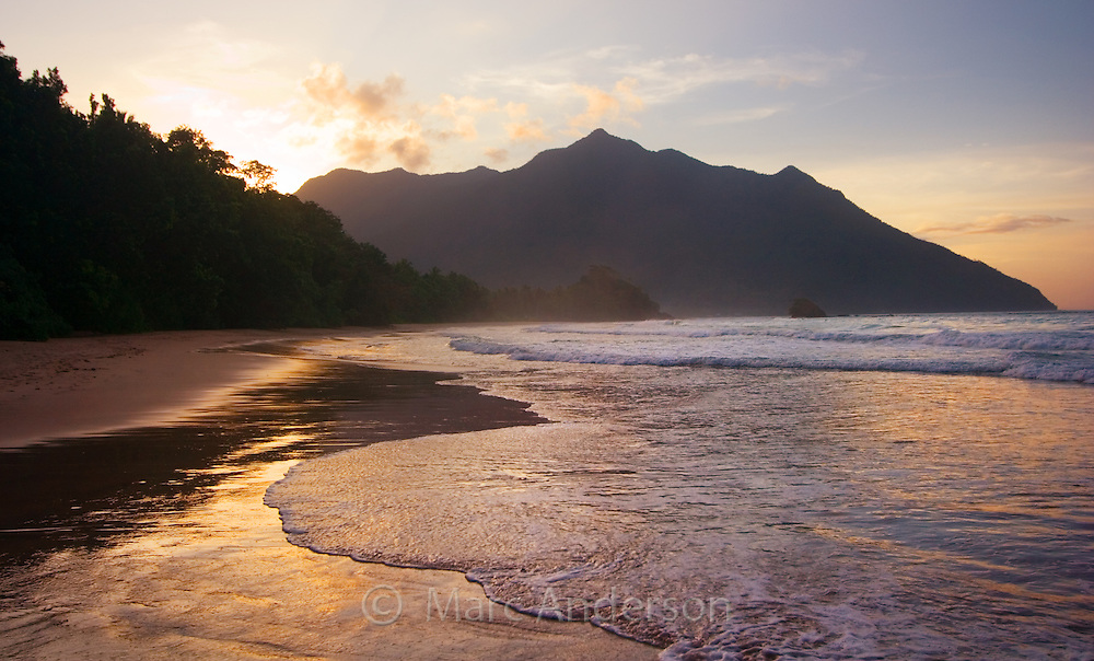 Sunset & clouds on a beautiful tropical beach in the Puerto Princesa Subterranean River National Park, Palawan, Philippines