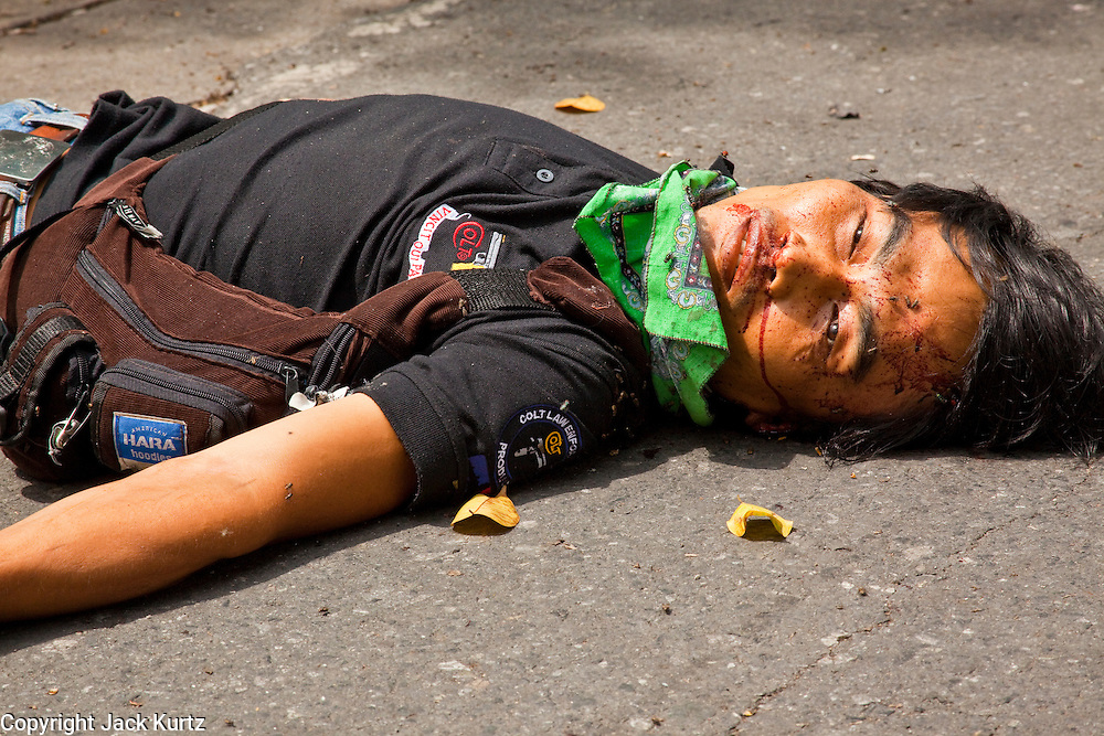 May 19 - BANGKOK, THAILAND: A dead Thai anti government protester in Lumpini Park during the Thai government crack down against Red Shirt and anti government protesters. The Royal Thai Army attacked anti-government protesters May 19 with troops and armored personnel carriers. Photo by Jack Kurtz