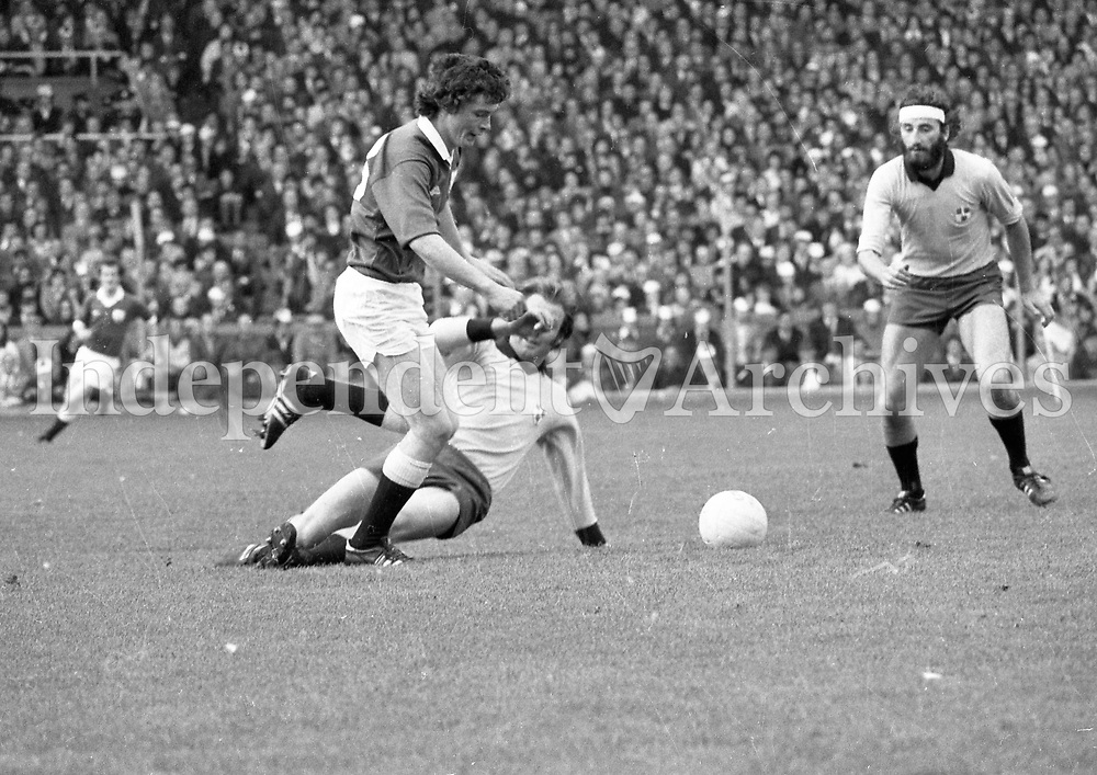 Galway's Tom Naughton tries to set a Galway attack during the 1974 All-Ireland Football Final at Croke Park as Dublin's Stephen Rooney and  Alan Larkin come to tackle. (Part of the Independent Newspapers Ireland/NLI collection.)