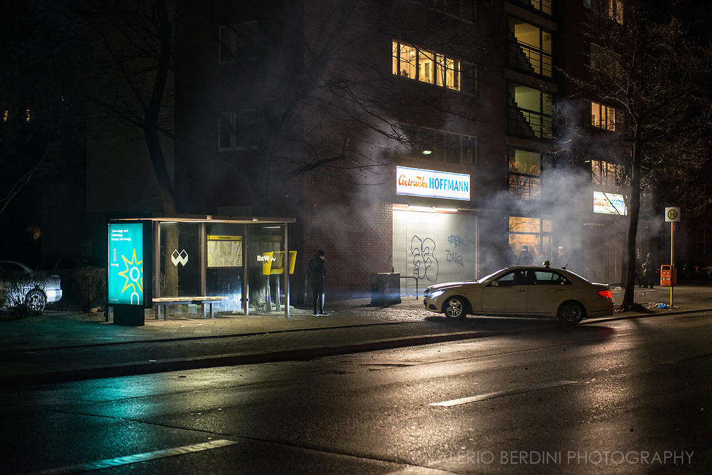 Ghosts, fireworks, smoke. A street in Berlin on New Year's Eve.