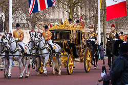 London, March 3rd 2015. Mexican President Enrique Pena Nieto travels with Her Majesty The Queen and other members of the Royal Family by State Carriage along the Mall towards a luncheon at Buckingham Palace after a ceremonial welcome at Horseguards Parade. PICTURED: Her Majesty the Queen, Elizabeth II travels with Mexican President Enrique Pena Nieto in the State Carriage.