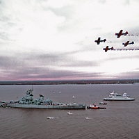 Aerial view of the USS New Jersey Battleship's final voyage up the Delaware river before being drydocked in Camden, NJ