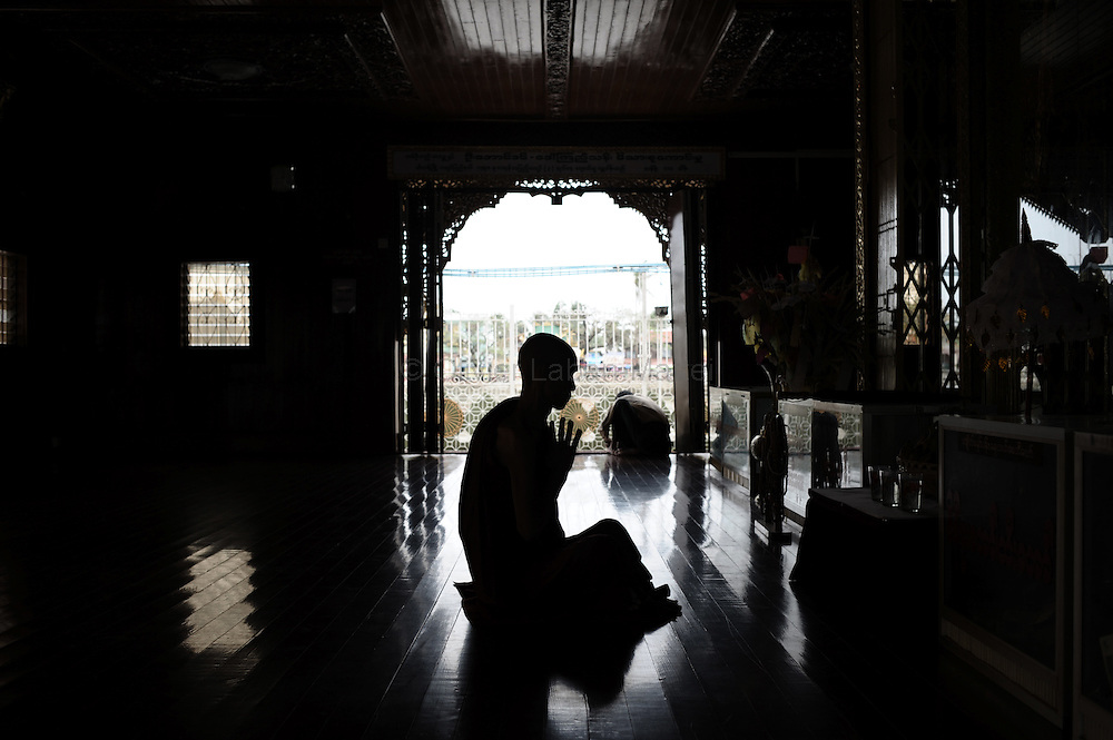 A Buddhist monk prays in the Ye Lai temple in Kyauktan on the outskirts of Yangon on May 16, 2008. Myanmar on May 16, 2008 said more than 133,000 people were dead or missing in the cyclone disaster, with the huge increase due to difficulties in confirming the figures, state television reported.
