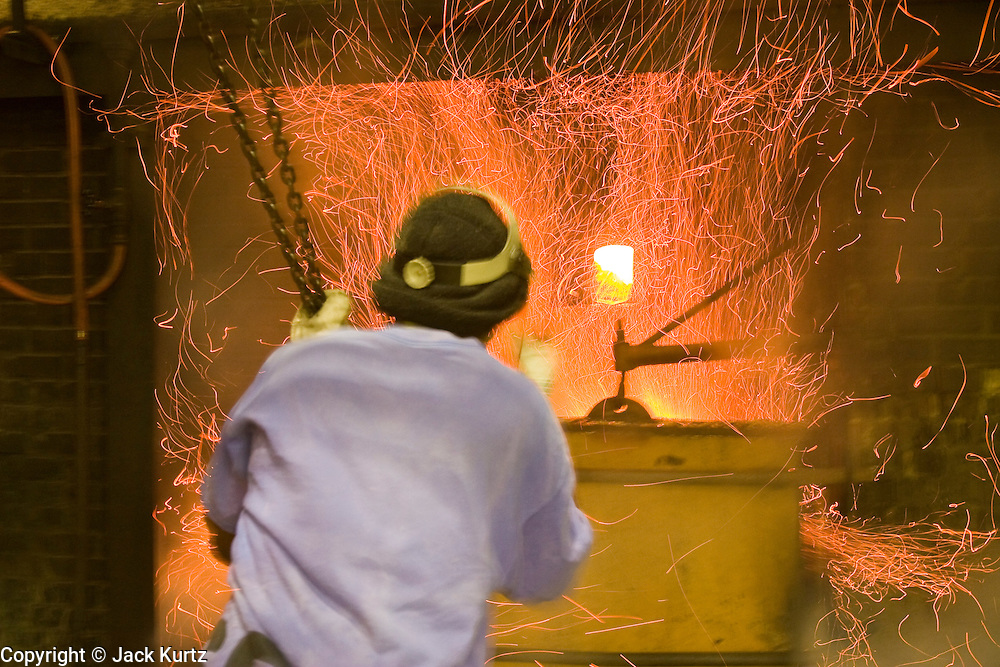15 NOVEMBER 2005 - FRANKLIN, LA:  WENDELL HENSLEY, bagasse burner at the St. Mary Sugar Co-Op Mill near Franklin, Louisiana, monitors the fires in the boilers during the 2005 sugar cane harvest. Louisiana is one of the leading sugar cane producing states in the US and the economy in southern Louisiana, especially St. Mary and Iberia Parishes, is built around the cultivation of sugar. The mill employs about 180 people. The two mills near Franklin contribute about $150 million (US) to the local economy. Sugar growers in the area are concerned that trade officials will eliminate sugar price supports during upcoming trade talks for the proposed Free Trade Area of the Americas (FTAA). They say elimination of price supports will devastate sugar growers in the US and the local economies of sugar growing areas. They also say it will ultimately lead to higher sugar prices for US consumers.   PHOTO BY JACK KURTZ