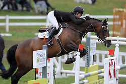 Katie McVean rides Dunstan Daffodil in a wet and muddy round 4 of the FEI World Cup qualifier, Taupo, New Zealand, Saturday, December 17, 2011. Credit: SNPA / Kerry Marshall