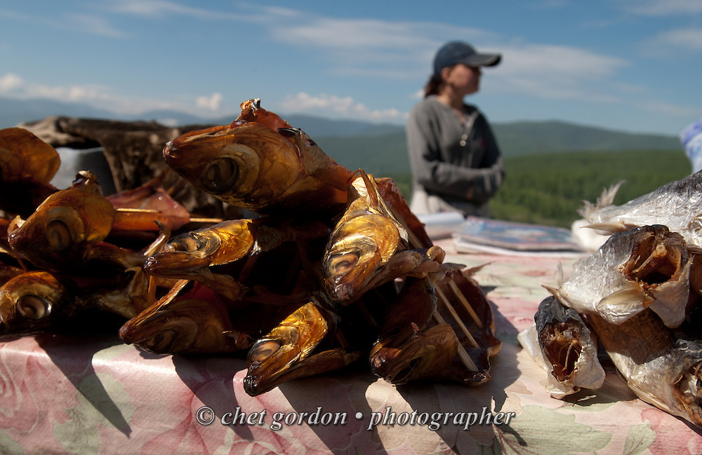 A woman pauses near her omul fish stand near Lake Baikal, Siberia - Russian Federation on June 15, 2005.