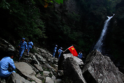Chinese communist party course trainees dressed in Red Army uniforms visit Longtan waterfall in Jinggangshan of Jiangxi Province, China, 15 October 2012. Jinggangshan or Jinggang mountain is a popular destination for Red Tourism where Chinese communist party cadres and ordinary Chinese tourists alike converge, seeking to relive the experiences and rekindle the spirit of the revolutionaries. It is deemed as the birthplace of the Chinese Red Army and the 'cradle of the Chinese revolution' which saw Communist leader Mao Zedong's ascent to power as a revolutionary. After a failed uprising in 1927, Mao fled into the mountains with his 1,000 remaining troops from nationalist forces and set up base here to reorganize his army, eventually defeating the Kuomingtang (KMT) to rule the country. Cadres dressed in Red Army uniforms attending Communist party training courses in are a common sight in the various historical sites of the mountain where they sing red songs and retrace the paths taken by their forbears. The Chinese communist party is slated to hold its 18th national congress on 08 November where a major leadership transition will see current leaders President Hu Jintao and Premier Wen Jiabao make way for a new generation of leaders helmed by Xi Jinping, With more than 80 million members, the Chinese Communist Party is hard pressed to display a show of unity and power after  scandals the ousting of disgraced politician Bo Xilai roiled the country. .