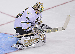 Oct 8; Newark, NJ, USA; Dallas Stars goaltender Kari Lentonen (32) makes a blocker save during the third period at the Prudential Center. The Stars defeated the Devils 4-3 in overtime.