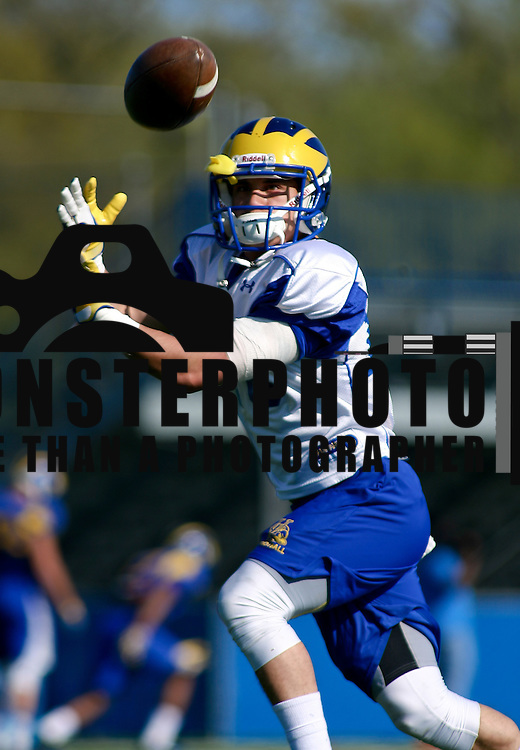 Delaware Cornerback Sam Miller (16) attempts to catch a pass during defensive back drills Thursday, April. 25, 2013, at Delaware practice field in Newark Delaware.
