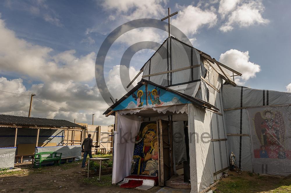 Calais, Frankreich - 17.10.2016<br /> Eine Kirche f&uuml;r &auml;thiopische und eritreische Christen   steht im Dschungel von Calais. Das Fluechtlingscamp an der Kueste zum Aermelkanal soll laut franz&ouml;sischer Regierung in den n&auml;chsten Tagen geraeumt werden. In dem Camp leben um die 1000 Fluechtlinge und warten auf die Moeglichkeit zur Weiterreise durch den Eurotunnel nach Gro&szlig;britannien. Photo: Foto: Markus Heine / heineimaging<br /> <br /> Calais, France - 2016/10/17<br /> A Church for Ethiopian and Eritrean Christians stand in the Calais Jungle. The refugee camp on the coast to the English Channel is to be cleared in the next few days, according to the French government. In the camp live around the 1000 refugees and wait for the possibility to travel further through the Eurotunnel to the UK. Photo: Foto: Markus Heine / heineimaging<br /> <br /> ------------------------------<br /> <br /> Ver&ouml;ffentlichung nur mit Fotografennennung, sowie gegen Honorar und Belegexemplar.<br /> <br /> Bankverbindung:<br /> IBAN: DE65660908000004437497<br /> BIC CODE: GENODE61BBB<br /> Badische Beamten Bank Karlsruhe<br /> <br /> USt-IdNr: DE291853306<br /> <br /> Please note:<br /> All rights reserved! Don't publish without copyright!<br /> <br /> Stand: 10.2016<br /> <br /> ------------------------------