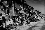 Most of the vast slums of Manila's Tondo District in the Philippines are not only just a few meters above sea level but, in a seismically active area, are built on reclaimed land beside Manila Bay.  <br /> <br /> On Maplecroft's Climate Change Vulnerability Index, Manila ranks as the world's second most vulnerable city to climate change.  Manila's Tondo is Manila's district most vulnerable to climate change-induced sea rises, storm surges from increasingly strong typhoons and earthquake trigger tsunami.  It has a population density of nearly 78,000 people per square km (202,800 ppl/sq mi), according to a 2009 Cornell University report.  (Note: Manhattan has a population density of 26,939/km2 [69,771/sq mi].)<br /> <br /> While the extreme poverty rate in the region dropped significantly between 2005 and 2008, the Philippines' poverty rate remained largely unchanged.  In fact, poverty has intensified on the poor.  According to the National Statistics Coordination Board (NSCB) in 2006, 28.8% of families lived on less than US$1.25/ day.  By 2012, 27.9 % of Filipinos were living below the poverty line.  <br /> <br /> What what changed was the income per family needed to escape extreme poverty.  While in 2006, a family would need to earn US$39.09 / month to escape extreme poverty, that figure rose in the most recent NSCB survey to US$ 181.89/month, clear showing how inflation is weighing heaviest upon that society's poor.