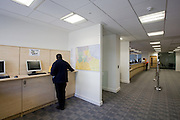 A man uses Internet area and reception desk
