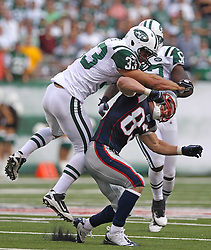 Sept 19, 2011; East Rutherford, NJ, USA; New York Jets safety Eric Smith (33) hits New England Patriots wide receiver Wes Welker (83) in the head during the 1st half at the New Meadowlands Stadium.