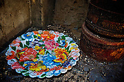Plastic plate with flowers and butterflies and biscuit tins. Jaffna homes. 2011