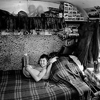 Warsaw - Poland:  Khazak acrobat child reads while practising in a caravan in Warsaw, November 1992. The circus performers are all former Soviet union citizens from the southern republics. (Greg Marinovich / Getty Images)