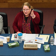"Justice Mary Fairhurst, Nick Brown (left), and William Hyslop (right) at the ""Three Hardest Questions"" in justice event April 7 at Gonzaga Law School. (Photo by Edward Bell)"