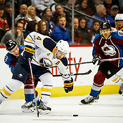 SHOT 2/25/17 9:23:52 PM - The Buffalo Sabres' Josh Gorges #4 chases after a puck as the Colorado Avalanche's Matt Duchene #9 closes in during their NHL regular season game at the Pepsi Center in Denver, Co. The Avalanche won the game 5-3. (Photo by Marc Piscotty / © 2017)