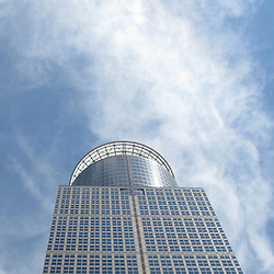 The top of a Minneapolis Skyscraper as set against a dramtic wispy clouded sky