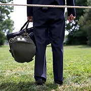 A US Secret Service agent stands post as Pres. Bush attends a tee-ball game Monday, June 30, 2008. ..Photo by Khue Bui