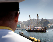 """15th February 2010. Muscat. Oman..Pictures of an Omani naval officer watching """"The Jewel of Muscat"""" leaving the port and Oman today. Recreating the origanol historic journey to Singapore."""