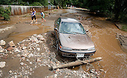 BOULDER, CO - SEPTEMBER 13: A stranded car sits in the middle of Topaz Street in Boulder, Colorado as heavy rains for the better part of week fueled widespread flooding numerous Colorado towns on September 13, 2013. Local residents said the Four Mile Canyon Creek that runs nearby is usually a trickle at this time of year. (Photo by Marc Piscotty/ © 2013)