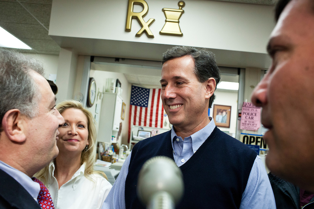 Republican presidential candidate Rick Santorum, third from left, meets with voters at Hollis Pharmacy and General Store on Saturday, January 7, 2012 in Hollis, NH. Brendan Hoffman for the New York Times