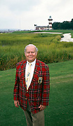 Charles Fraser poses on Harbour Town's 18th fairway. Fraser developed Harbour Town, the Harbour Town Golf Links and Sea Plines Plantation, along with other parts of the then-forested Hilton Head Island. He was considered a pioneer in coastal development, especially in the South.