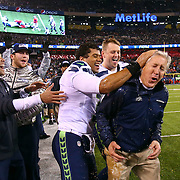 Seattle Seahawks quarterback Russell Wilson celebrates with coach Pete Carroll after Carroll was hit with Gatorade in the final minutes during the Super Bowl on Sunday, February 2, 2014 at MetLife Stadium in New Jersey. The Seahawks dominated the Denver Broncos 43-8, winning their first NFL title. (Joshua Trujillo, seattlepi.com)