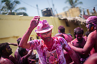 A man seen dancing during Holi festival in streets of Hampi, Karnataka, India, on  March 5, 2015. Holi, also known as the Festival of Colors, heralds the beginning of spring and is celebrated all over India.<br />