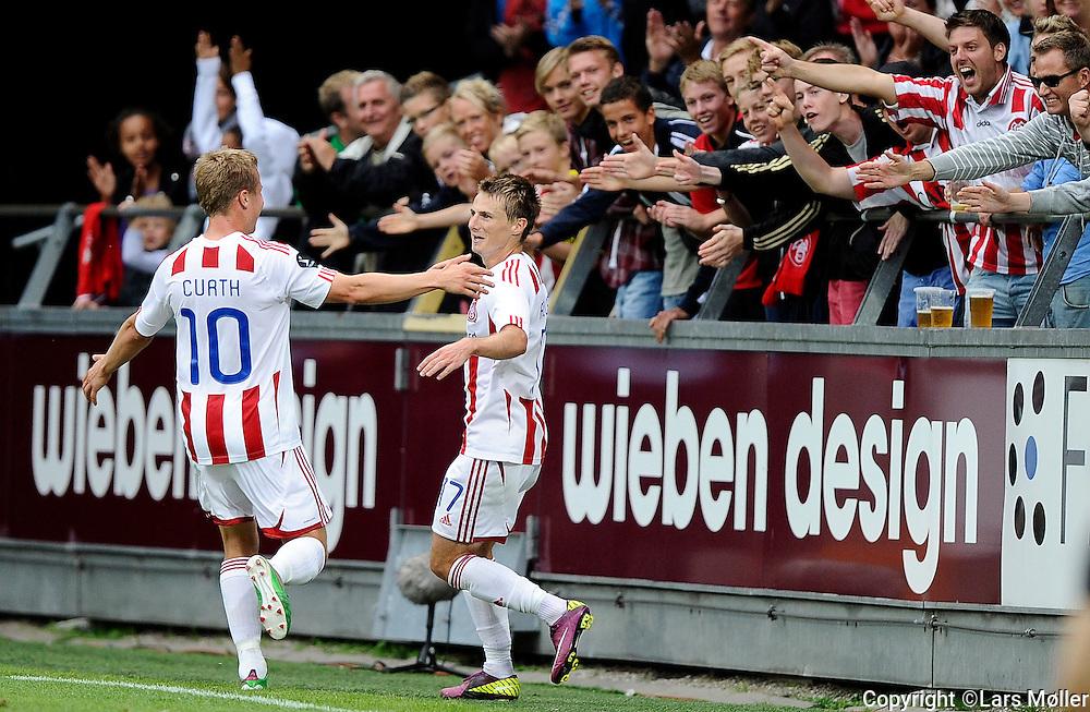 DK Caption:<br /> 20110813, &Aring;lborg, Danmark:<br /> Superliga fodbold, AAB - OB:<br /> Chris Rolfe, Aab Aalborg. har scoret til 2-0<br /> Foto: Lars M&oslash;ller<br /> <br /> UK Caption:<br /> 20110813, Aalborg, Denmark:<br /> Superleague football  AAB - OB:<br /> Chris Rolfe, Aab Aalborg. har scoret til 2-0<br /> Photo: Lars Moeller