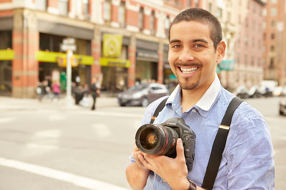 Portrait Photograph in New York City of smiling Hispanic professional photographer
