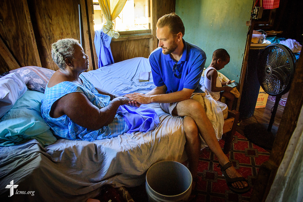The Rev. Duane Meissner, career missionary to Belize, prays with Lovina during a visit to her home on Tuesday, Sept. 27, 2016, in the village of Seine Bight, Belize. Meissner's objective is to plant the first Lutheran churches in the country. LCMS Communications/Erik M. Lunsford