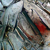 A view at the microscope of salt and sugar crystals in polarized light.