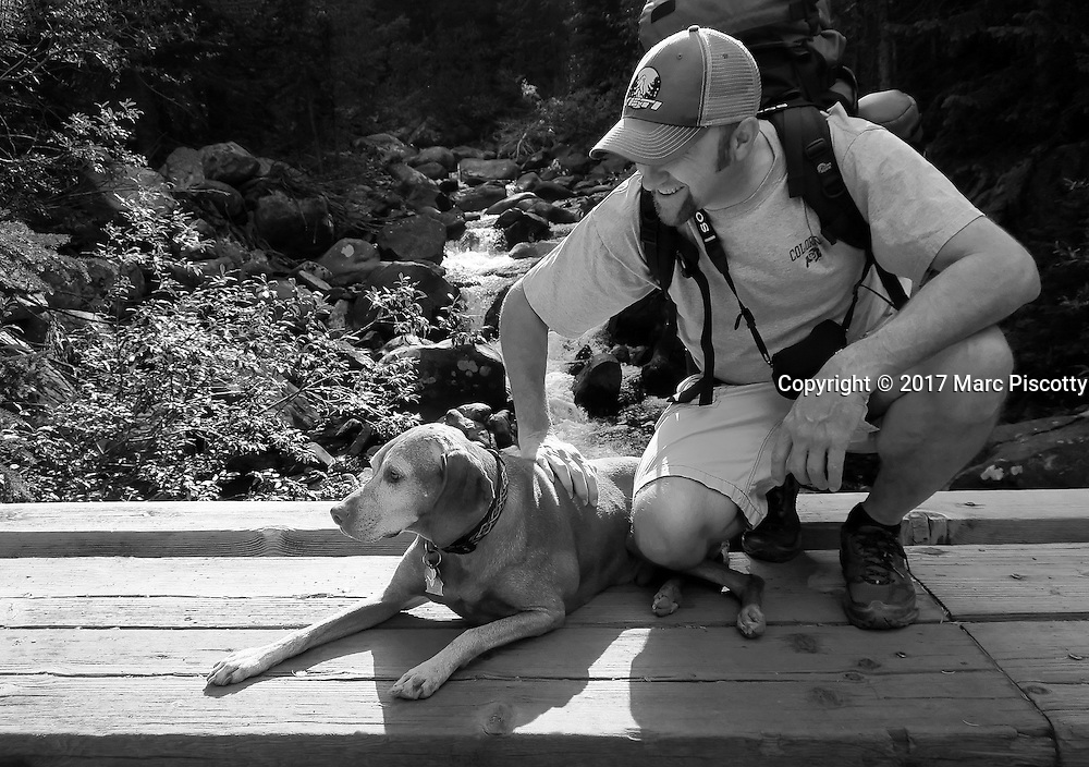 SHOT 9/9/16 4:14:54 AM -  Marc Piscotty of Denver, Co. hiking with his dog Tanner, a 12 year old male Vizsla along the Hessie Townsite trails in Nederland, Co. (Photo by Marc Piscotty / © 2017)