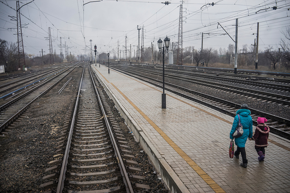 People walk on the platform near a train housing dozens of people who fled heavy fighting between pro-Russia rebels and Ukrainian forces on Monday, February 9, 2015 in Slovyansk, Ukraine.