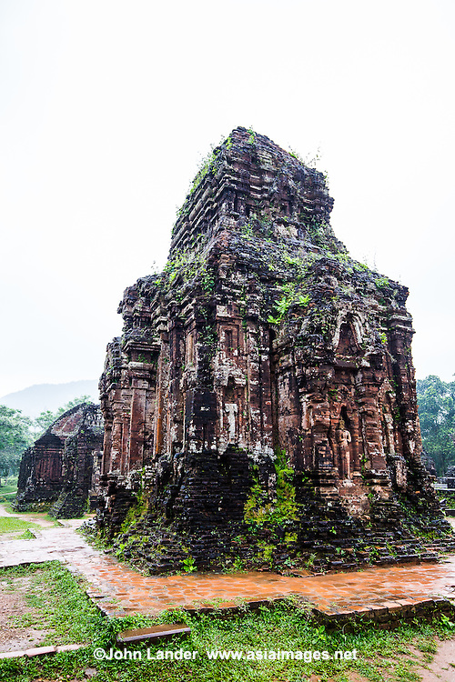 My Son Ruins & Sanctuary are set in a small valley in Quang Nam Province, about 40km from Hoi An City. Of the Cham ruins in Viet Nam, My Son possesses several monuments and epitaphs, which are even now being being studied by archeologists.  Each new monarch came to My Son after his accession to the throne, for the ceremony of purification and to present offerings and erect new monuments. The temples at My Son were built into groups that basically followed the same model. Each group was comprised of a main sanctuary surrounded by towers and supplementary monuments dedicated to Shiva. The smaller temples are devoted to the spirits of the eight compass points.