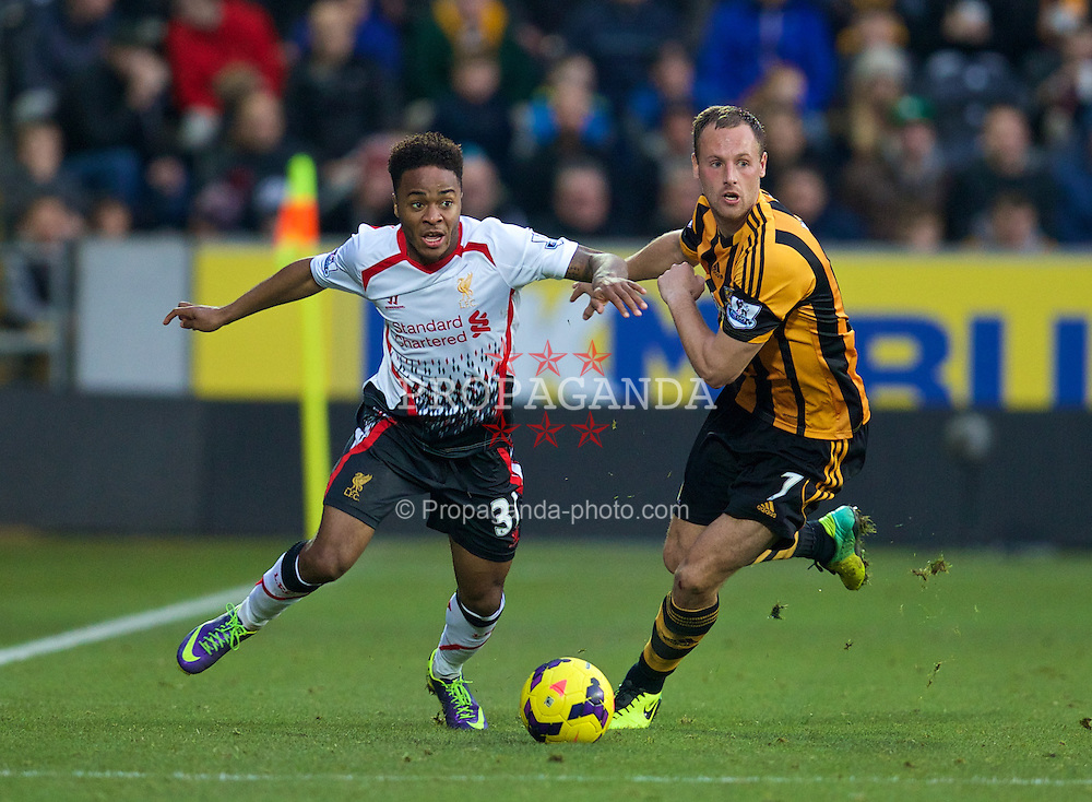 HULL, ENGLAND - Sunday, December 1, 2013: Liverpool's Raheem Sterling in action against Hull City's David Meyler during the Premiership match at the KC Stadium. (Pic by David Rawcliffe/Propaganda)