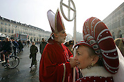 SHOT 2/18/2006 -  Walking the streets of Torino, Italy in historical outfits residents of Torino, Italy put on a show for visitors in a plaza during the 2006 Winter Olympics in the city. Turin (Italian: Torino; Piedmontese: Turin pronounced) is a major industrial city as well as a business and cultural centre in northern Italy, capital of the Piedmont region, located mainly on the west bank of the Po River. The population of the city of Turin is 908,000 (2004 census); its agglomeration totals about 1.7 million inhabitants, while its metropolitan area has a population of 2.2 million inhabitants. The company Fiat automobile manufacturer has its headquarters here and many other Italian car brands such as Lancia were born here: hence Turin has been nicknamed the Automobile Capital of Italy. It was the first capital of the unified Italy. The best known building of the city is the Mole Antonelliana, whose construction began in 1863 and which today houses the National Cinema Museum. Turin is the birth place of solid chocolate. It was in Turin that, at the end of the 18th century, Mr. Doret invented a revolutionary machine that could make solid chocolate (as opposed to drinking chocolate)..(Photo by MARC PISCOTTY/ © 2006)