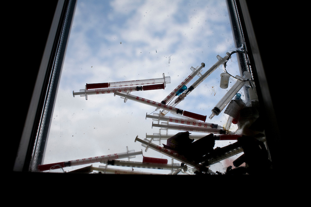Used needles are trapped between windows in the stairwell of an apartment building in Kazan, Russia, on Saturday, September 22, 2007.