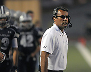pvc093011b/9-30-11/asec.  La Cueva head football coach Ed Lucero (CQ), watches as his team trails Mayfield in the first half of Friday night's game at Wilson Stadium Sept. 30, 2011. (Pat Vasquez-Cunningham/Journal)
