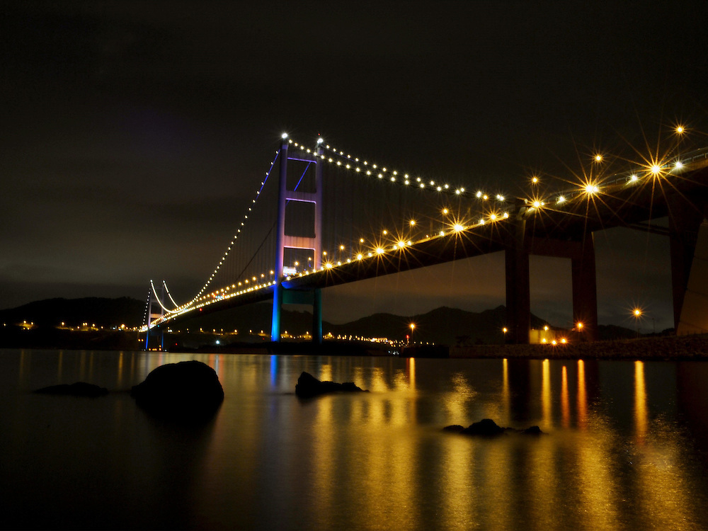 Tsing Ma Bridge 2016 by Joan Pabona.<br /> <br /> Joan Pabona is 33 years old and from the Philippines. She has been using a Fuji film camera since I was in college. Photography is a stress reliever for Joan due to the hard work of week days. She is currently studying whilst attending workshops for creating artistic photos and learning different techniques. She has organised some events for domestic workers like 'Photowalk' in order to apply their knowledge about photography and what they have learned from Lensational. Some of Joan's works have been featured in the number one leading newspaper in Philippines.
