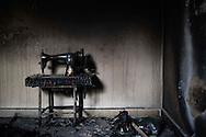 SYRIA, Idlib province: A sewing machine lies ruined in a burned house a few days after troops of the Al Assad regime entered  the village to destroy and burn houses of allegedly pro revolution activists on April 11, 2012. ALESSIO ROMENZI