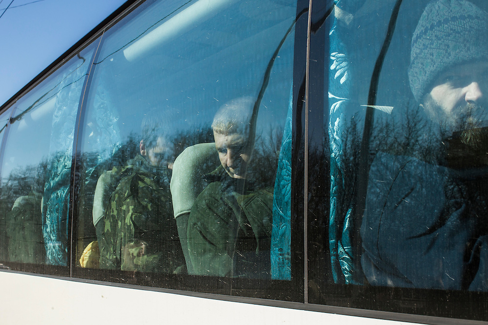 DONETSK, UKRAINE - FEBRUARY 21: Ukrainian prisoners of war wait on a bus for transfer to a prisoner exchange on February 21, 2015 in Donetsk, Ukraine. A ceasefire agreement between rebels and Ukrainian forces is at risk of falling apart after fierce fighting forced the Ukrainians to withdraw from the strategic town of Debaltseve.