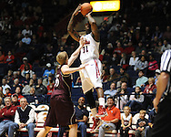 "Ole Miss' Murphy Holloway (31) shoots over Louisiana Monroe's Trey Lindey (35) at the C.M. ""Tad"" Smith Coliseum in Oxford, Miss. on Friday, November 11, 2011. Ole Miss won 60-38 in the season opener."