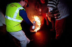 "OTTER ST MARY . TAR BARRELS NOVEMBER THE 5TH .""PARAFFIN MAN""..RUPERT RIVETT © 2003"