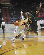 "Ole Miss guard Chris Warren (12) drives against Southeastern Louisiana's Brandon Fortenberry (5) at the C.M. ""Tad"" Smith Coliseum in Oxford, Miss. on Sunday, January 2, 2011. (AP Photo/Oxford Eagle, Bruce Newman)"