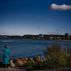 An older woman looks out at the Gulf of Finland in Tallinn, Estonia in Sept. 2009. The young democracy joined the European Union in 2004 and since has been working on getting the euro as its national currency. Estonia has one of the highest per capita incomes in central europe..