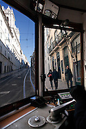View from the inside of a Lisbon's nº28 yellow tram uphill at Calçada do Combro, on his way through the central, most historic region of the city.