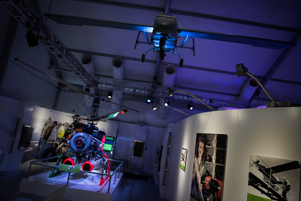 """30206010A - DRONES -  AAI RQ-2 Pioneer, right, hangs above the entry at the """"Drones: Is the Sky the Limit?"""" exhibit at the Intrepid Sea, Air, and Space Museum in New York, NY on May 9, 2017."""